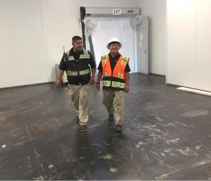 SERVPRO Project Managers Walking Empty Retail Location