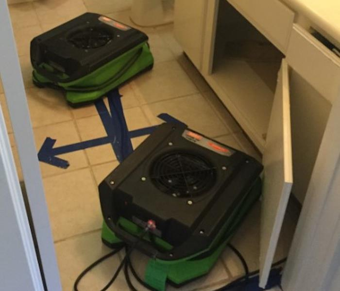 Water Damaged Bathroom with SERVPRO equipment